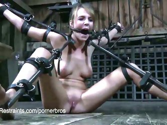 Strict bondage in the barn for this hot bitch