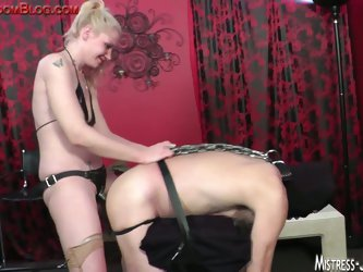 Horny mistress fucking her slaves ass.