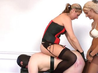 Hot mistresses torturing their slave