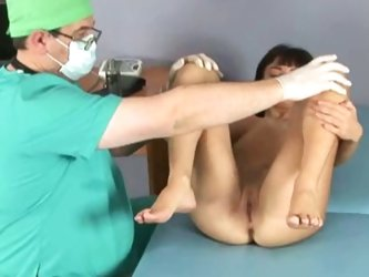 Doc performs medical exam on young brunette girl