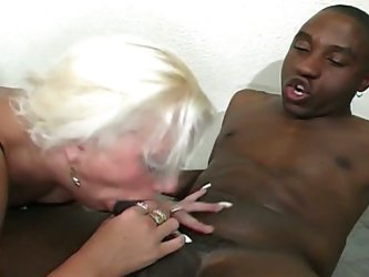 Horney blonde whore nibbles choco cock