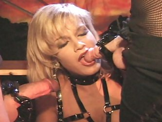 Blonde in latex double pussy fucked