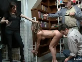 Babe blows some dicks in the library with a collar on her neck