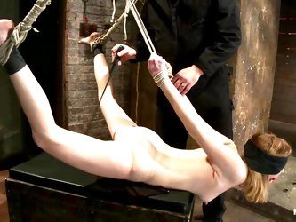 Blindfolded and tied up Mallory Mallone in BDSM video
