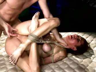 Tied up girl gets humiliated and face fucked in BDSM vid