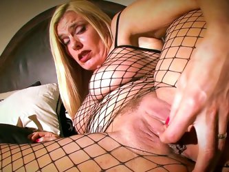 Darryl Hanah poses in her cute black fishnet