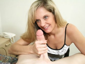Milf Cami loves it when Billy gets blue balls, that means she gets to stroke it, and make his cock cum. The drunk milf strokes it until he erupts milk