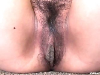 Horny asian brunette plays with her hairy pussy