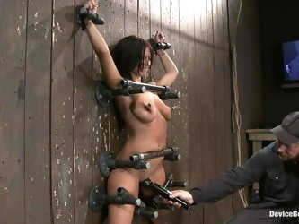 Halie James moans in pleasure while being tormented in BDSM scene