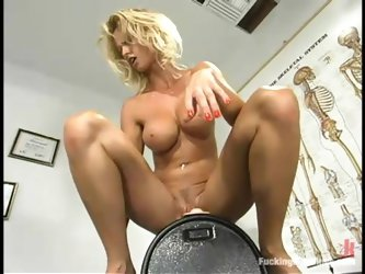 Desirable blondie is playing with a fucking machine