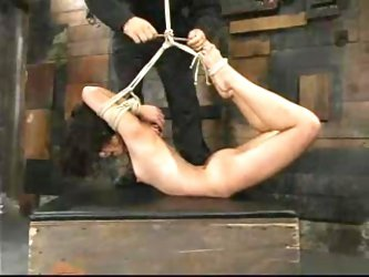 Crimson Ninja gets her snatch fucked with a dildo in a basement