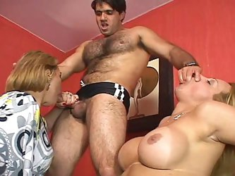 Hot tempered mom joins aroused gay dude with sizzling shemale. The latter gives a head to kinky fucker, while an insatiable mom sucks her dick.