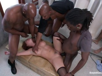 Big black cocks will fuck the hot busty redhead in this interracial gangbang that sees the girl getting double penetrated, throat fucked and taking mu