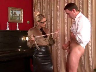 This guy is at his piano lesson. The teacher seems to be very severe cause when he misbehaves, she slams the piano shut and orders him to his knees. H