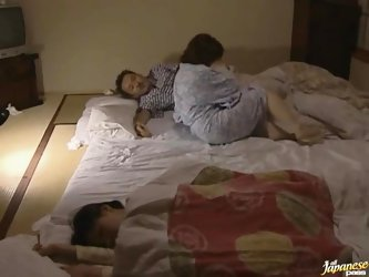 Horny Japanese lady and her elderly husband caress each other and bang on the floor in missionary position.