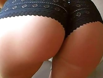 Her body is tight and sexy perfection from head to toe, something you can admire as she poses in her black lace boyshort panties.