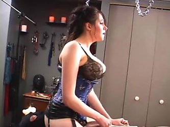 Goddess rides dildo on cuckold's chest