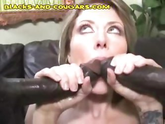 Naughty brunette MILF gets a mouthful with two pieces of dark meat