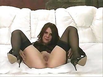 Lovely middle-aged whore in black stockings gets herself very horny