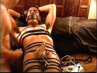 Bound and gagged I apply high voltage electro stim to my cute young bottom's balls juice out his nut
