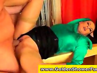 Kinky Lady In Satin Pissing On Guys Cock