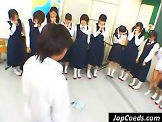 Horny Asian Teacher Lines His Students Up And Makes Them Lift Their Skirts