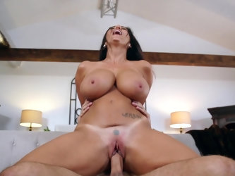 A horny couple is doing wonderful things in the living room. The brunette milf is suspended in the air while a cock is entering her snatch. After that