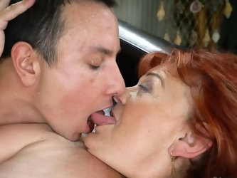 This redhead granny awaited for some things to be delivered to her house, and when she saw this hot young deliveryman, she immediately got wet and sta