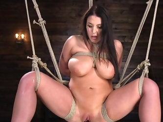 Dom approaches naked cougar with huge boobs and buries fingers deep into her wet pussy. Tied up goddess screams with pleasure as skillful man stuffs h