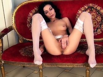 Petite babe in skimpy white lingerie teases her shaved pussy
