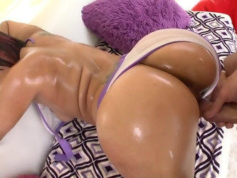 Buddy pours oil all over round butt cheeks of sultry mistress and in no time shoves long dick into welcoming pussy. They interrupts copulation only fo