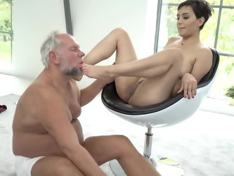 Old man worships feet of adorable young partner who returns the favor by polishing every inch of his thick cock. He moves on nearby chair so excited s