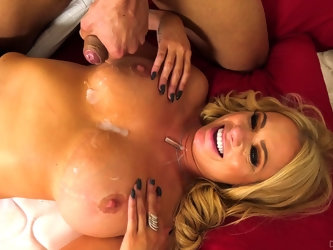 Busty mature bombshell Briana Banks gets a messy cumshot on her boobs