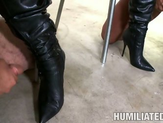 Two dicks fo two chicks. Jackie Daniels and her girlfriend love kinky sex. One guy shoots cum on her boots and she licks them off.