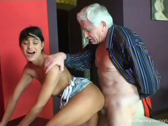 After riding a nasty hard cock of grey-haired grandpa in reverse cowgirl style, rapacious brunette hoe bends over a table to get fucked in doggy and m