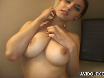 Gorgeous and busty Japanese slut Maria Ozawa talks to a guy on the phone and masturbates with an egg vibrator! Her tits are divine and sweet!