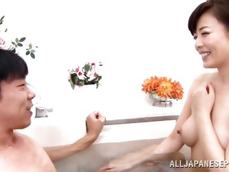 This salaryman has had a hard day, so he has visited a bathhouse and has invited a mature lady who works there to join him in the bathtub. She rubs hi