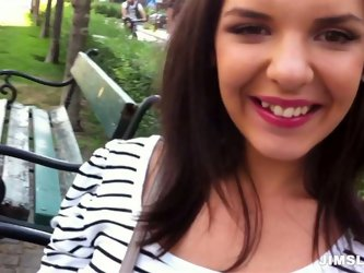Ardent and cute brunette meets a dude in the park. This gal is promised to paid well if she poses naked on cam. Smiling gal takes the lead and goes to
