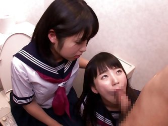 Two horny Japanese schoolgirls with tight bodies lock themselves in a toilet where a horny cock accompanies them to play a dirty game which involves f