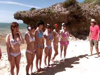 These teens on spring break just want to have some fun on the beach. A group of cock-hungry girls choose one lucky guy and they can't have wait,