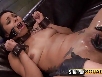 This dirty slut has cuff on her arms and a collar, around her neck so, that the mistress can take complete control of her. The slave's mouth is s