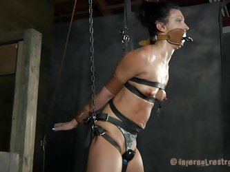 What do we have here? It's a slut, all tied up in leather belt and hangs there waiting to be punished. She was a very bad girl and her punishment