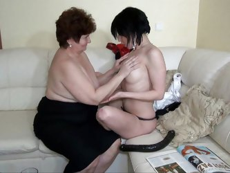 The brunette bitch was rubbing her cunt on that couch when grandma Hana found her. She was astonished of how slutty she is and decided to help. They&#