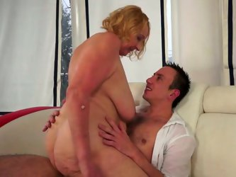 Perverse young dude makes out with a vast red-haired granny. He drills her stretched bald cunt from behind before she climbs on him for cowgirl ride i