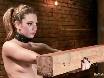 Dahlia Sky is led to the dungeon and she has to balance on one foot. She has a huge piece of lumber that her master makes her hold out in front of her