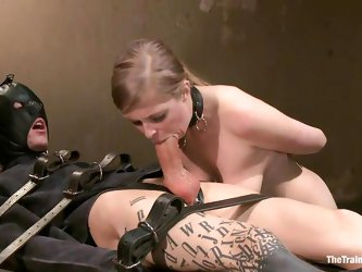 She's whipped on the ass and putted to work. An executor instructs her what to do and continues to whip her while she sucks and slurps the tied s