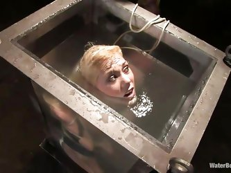 Samantha Sin is in a bit of a pickle. She's tied up and weighted down in a tall tank with little room to move. She gets off the bottom by herself
