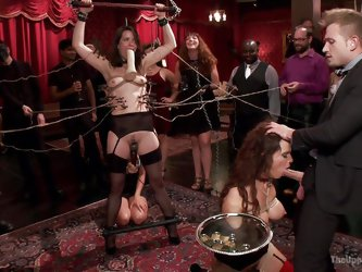 At this sex party the slave is made to serve the guest snacks. But she has something else in mind. The master has clamps on her nipples and rope tight
