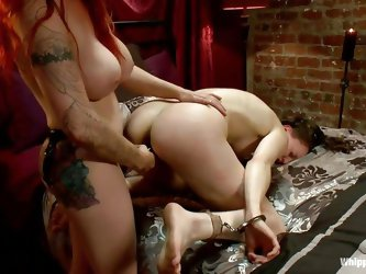 Redhead mistress Berlin adores to punish naughty sluts such as Bonnie. She grabs the cute slut by her hair and shovels her black strap on dildo in her