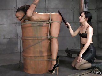 Are you into kinky activities involving powerful rope bondage? An ebony beauty with small tits is wearing high heels and a ball gag. A brunette mercil